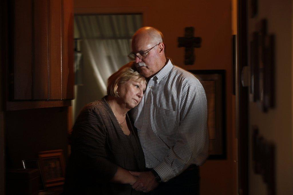 Most of the 22 military veteran suicides that occur each day do not involve people who served in Iraq or Afghanistan. The parents of Iraq war veteran Rusty McAlpin comfort each other near where their son killed himself with a handgun.