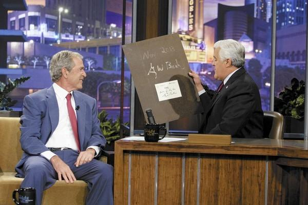 "Former President George W. Bush chats with ""Tonight Show"" host Jay Leno on Nov. 19, 2013."
