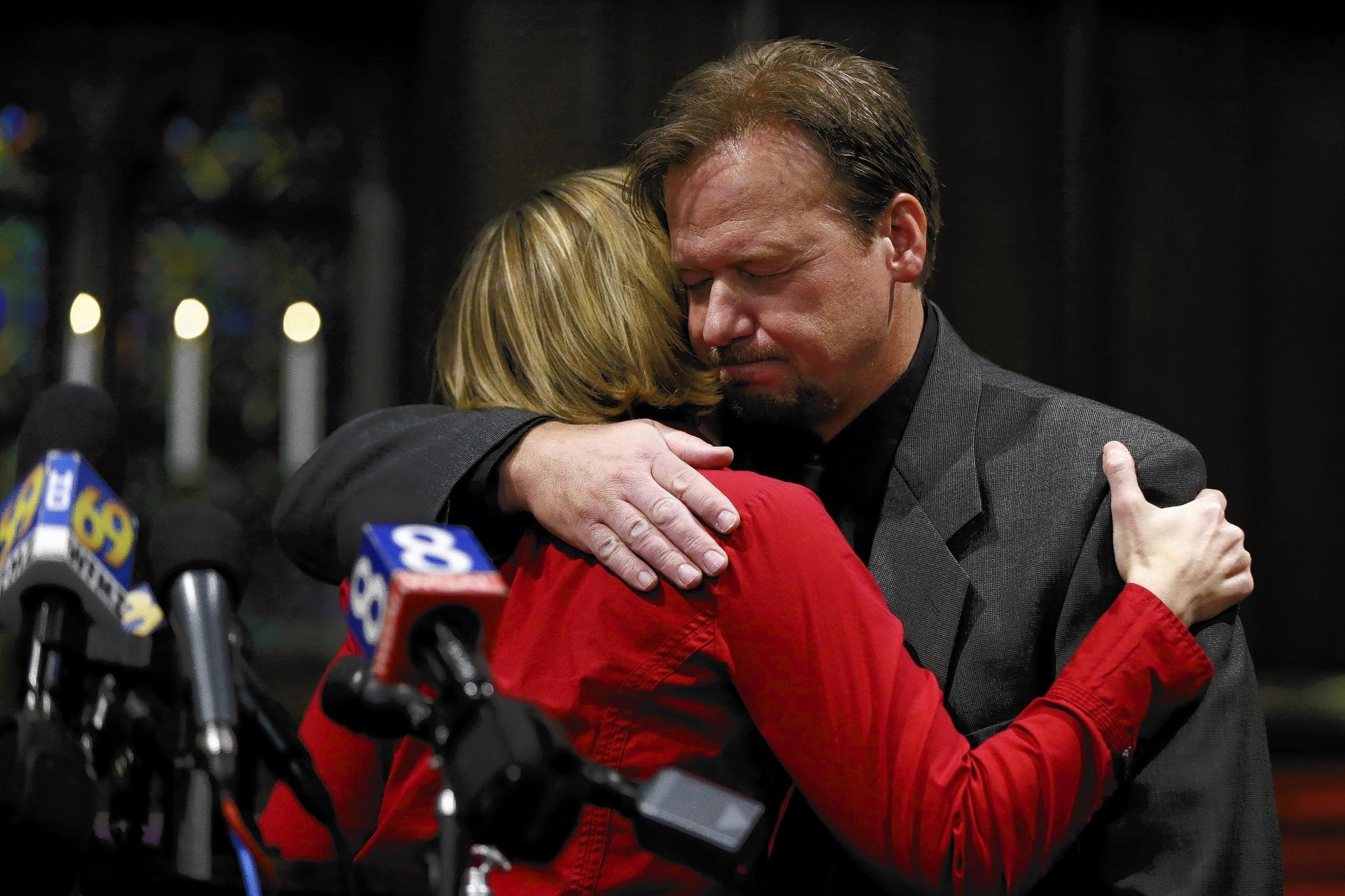 Former United Methodist pastor Frank Schaefer embraces the Rev. Lorelei Toombs during a news conference after the church announced its decision to defrock Schaefer for performing a same-sex marriage.