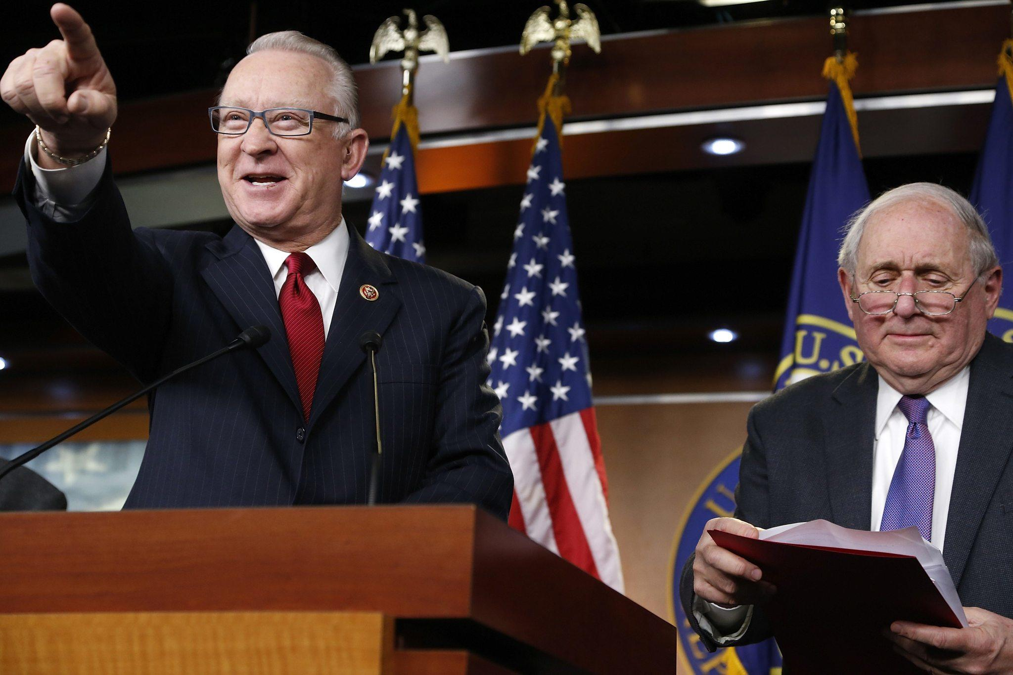 U.S. Representative Buck McKeon (R-CA) (L) and Senator Carl Levin (D-MI) (R), chairmen of the House and Senate Armed Services Committees, hold a news conference to talk about progress between the two chambers on the National Defense Authorization Act at the U.S. Capitol in Washington on Dec. 9.