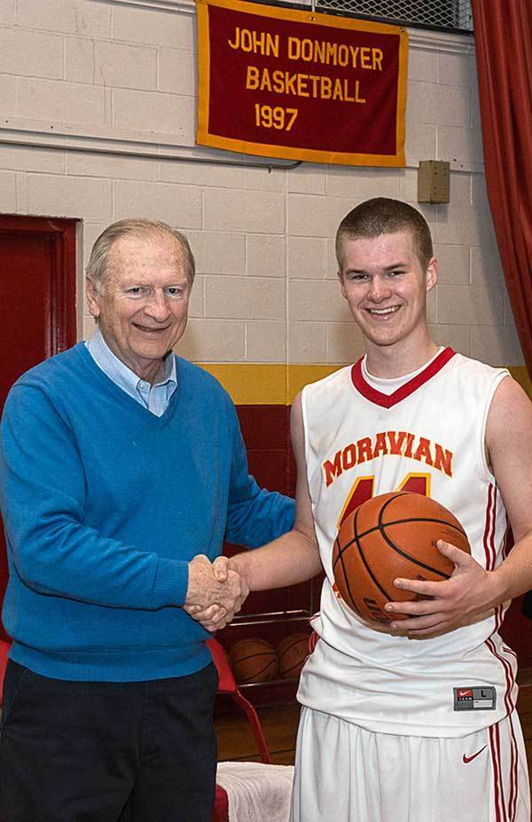 Moravian Academy player Luke Gutekunsts with Moravian Academy coach John Donmoyer