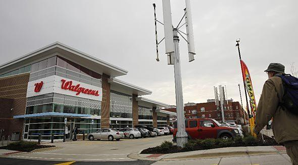 Wind turbines rise in November above an Walgreen's in Evanston, the nation's first new net-zero energy retail store.