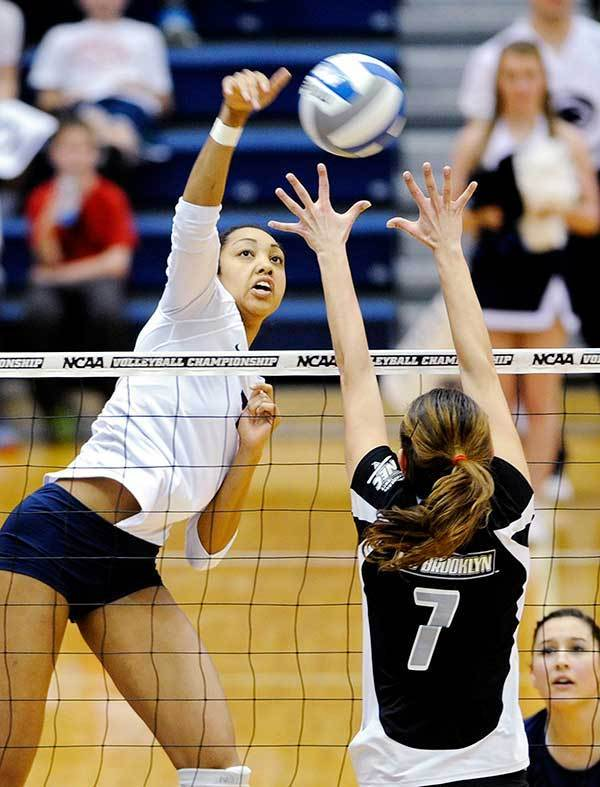 Penn State's Nia Grant, let, makes a kill over LIU Brooklyn's Hanna Gibeau during the first round of the NCAA women's volleyball tournament at Rec Hall in University Park, Pa., on Friday, Dec. 6, 2013.