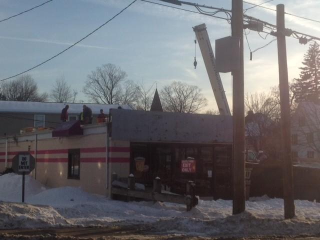 A crew works on rehabbing the former Sugar Shack on Center Street. The town's chief building official says the place is to reopen as a New York-style bagel shop.
