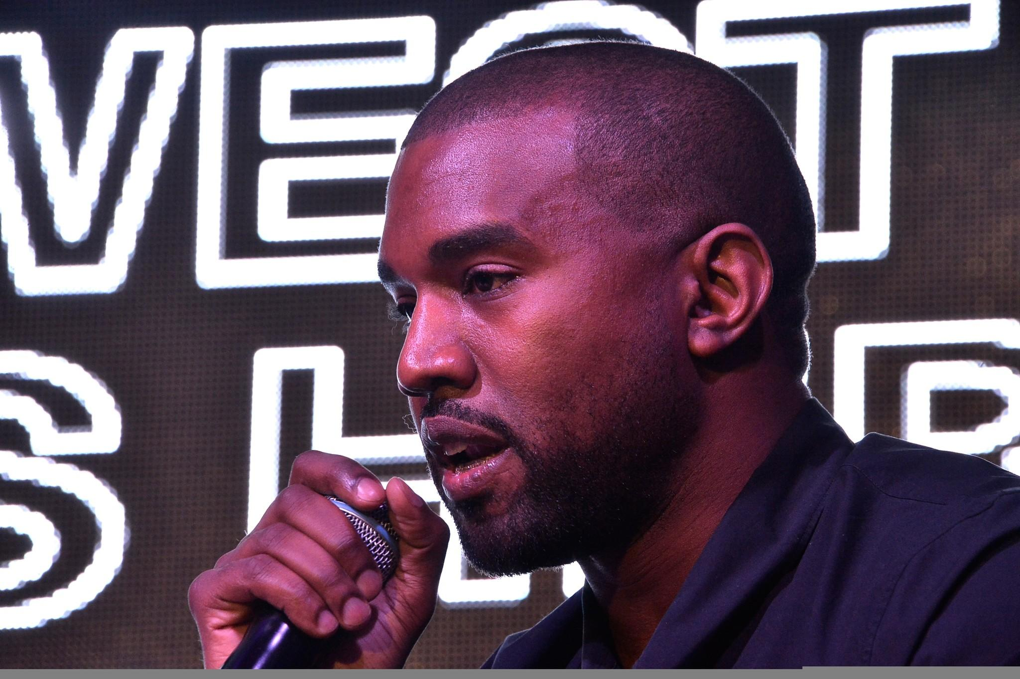 Kanye West speaking at event in Miami on Dec. 5.
