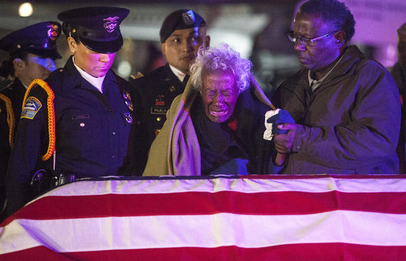 Clara Gantt, the 94-year-old widow of U.S. Army Sgt. Joseph Gantt, weeps in front of her husband's casket at Los Angeles International Airport.