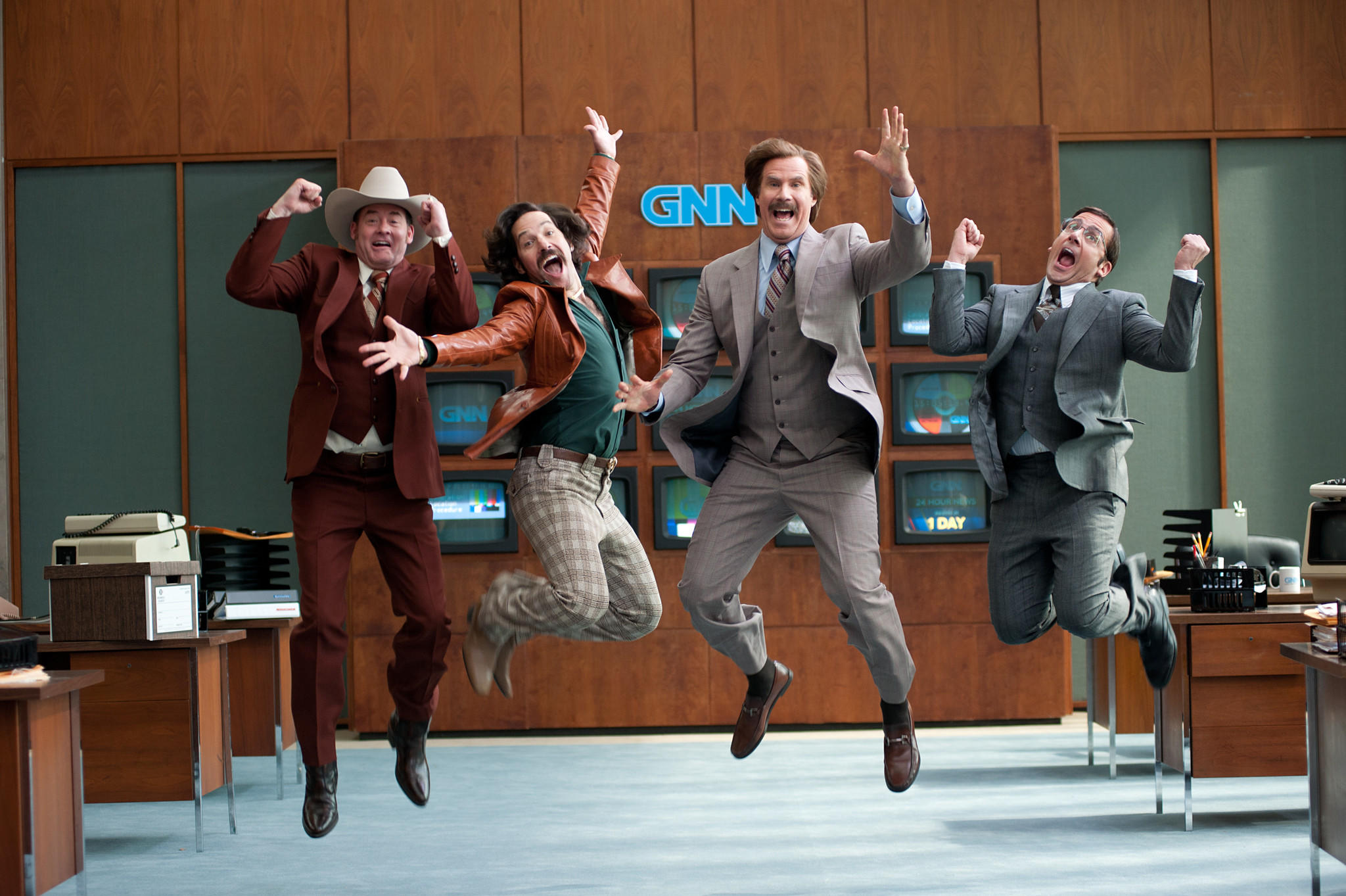 "Left to right: David Koechner is Champ Kind, Paul Rudd is Brian Fantana, Will Ferrell is Ron Burgundy and Steve Carell is Brick Tamland in ""Anchorman 2: The Legend Continues."""