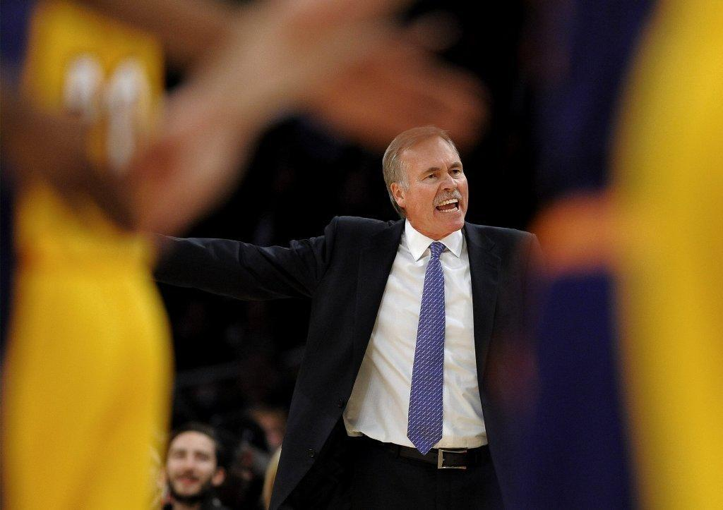 Lakers Coach Mike D'Antoni talks to his team during a game against the Phoenix Suns.