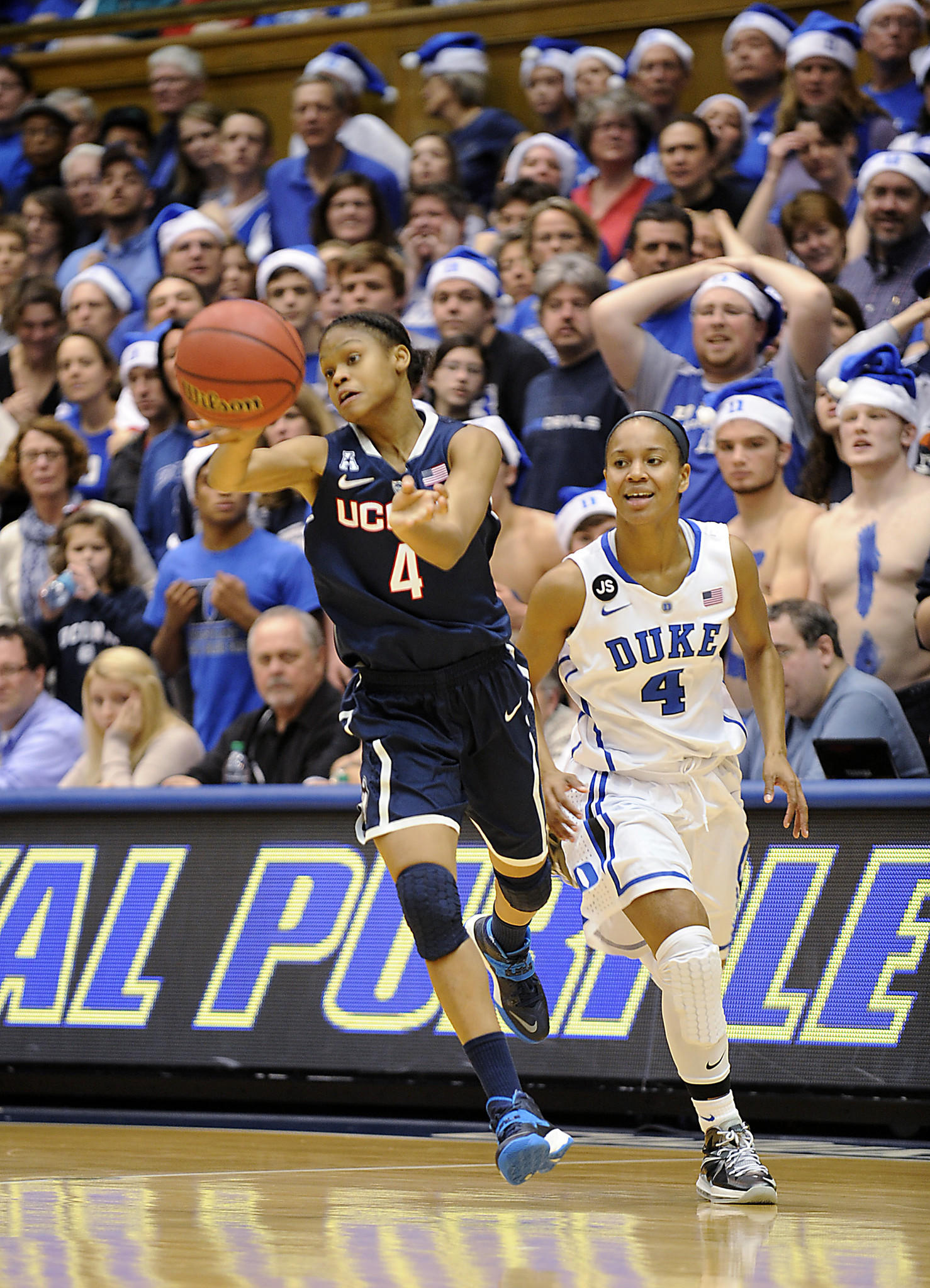Durham, NC 12/17/13 Connecticut Huskies guard Moriah Jefferson (4) pushes the ball ahead for one of her 7 assists against Chloe Wells (4) and Duke at Cameron Indoor Stadium in Durham, NC, Tuesday evening. Jefferson also scored 9 points with 3 steals to help the Huskies to an 83-61 victory. After the game head coach Geno Aureimma said he felt it was Jefferson's best game so far at UConn. Photo by JOHN WOIKE | woike@courant.com hc-uconn-women-duke-1218