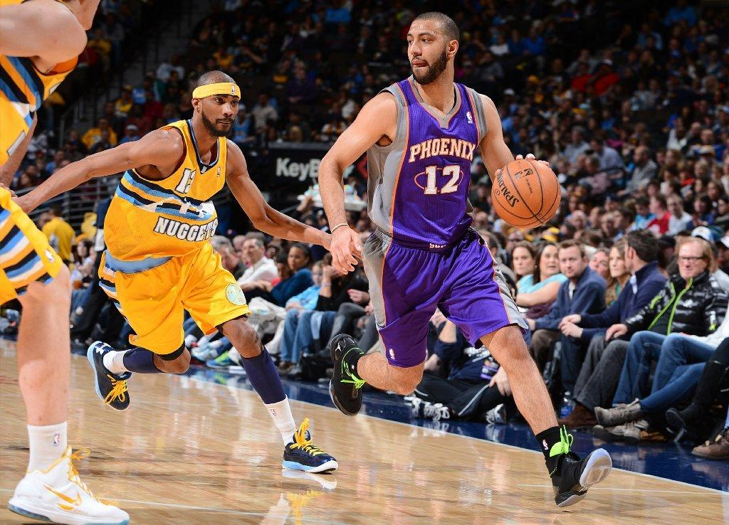 Point guard Kendall Marshall (12), who played for the Phoenix Suns last season before being traded to Washington and then waived, has been signed by the Lakers.
