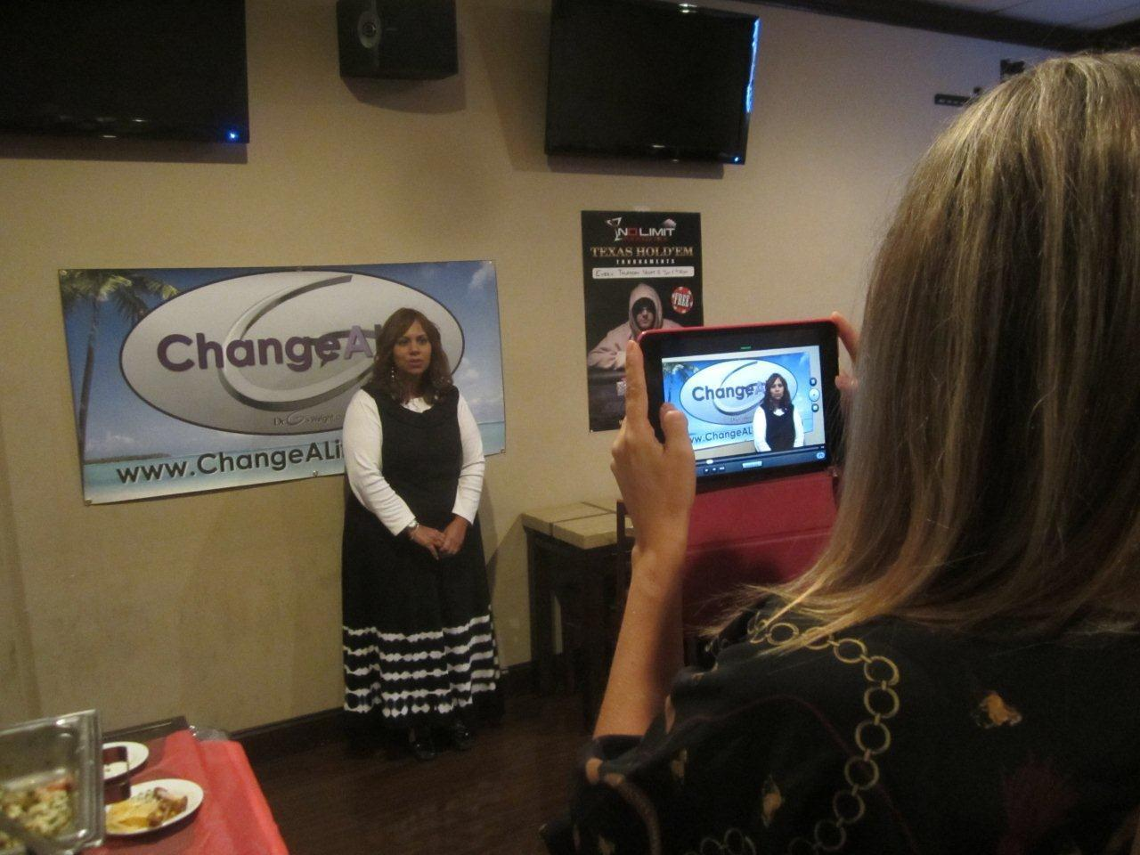 "Nechama Lichtenstein rehearses her 30-second video for ""Change A Life"" Boca Contest as Susan Wachowich records."