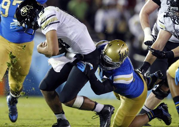 UCLA linebacker Isaako Savaiinaea, who will start in place of injured Eric Kendricks, sacks Colorado quarterback Sefo Liufau during a game earlier this season.