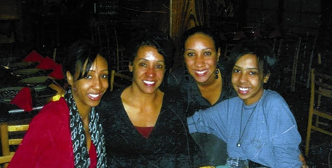 The family in modern times: columnist Sandy Banks, second from left, with daughters Danielle, left, Alyssa and Brittany Robinson in a 2010 photo