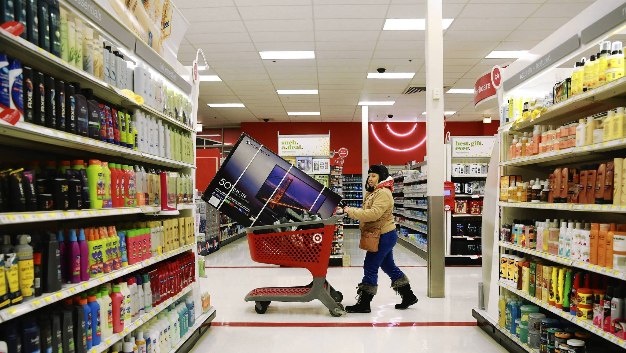 Vicky Varzenas, 28, walks past an aisle with television in her cart at the Target store on North Elston Avenue in Chicago, which opened at 8 p.m. on Thanksgiving.