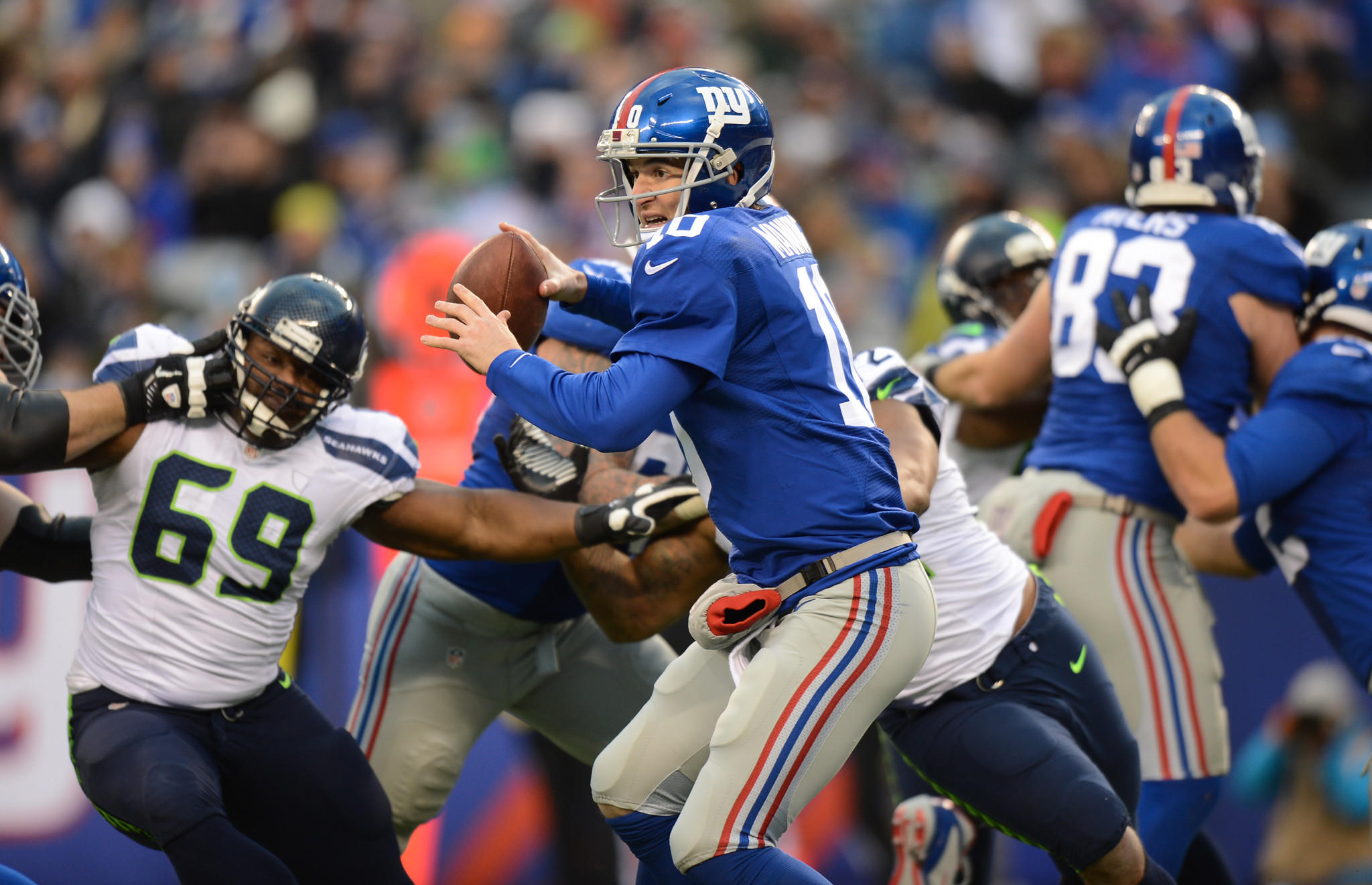 Quarterback Eli Manning of the New York Giants under pressure as he throws during the 2nd half of the Seattle Seahawks 23-0 win over the New York Giants at MetLife Stadium on Dec. 15.