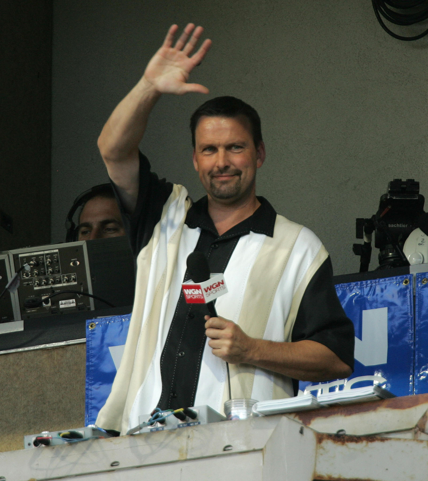 Former Cub great and fan favorite Mark Grace acknowledges the Wrigley Field crowd in the 7th inning.