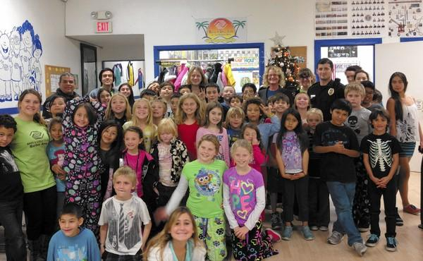 Newport-Mesa Unified School District Trustee Katrina Foley and officers from the Costa Mesa Police Department with the kids of the Lou Yatorn Boys & Girls Club in Costa Mesa.