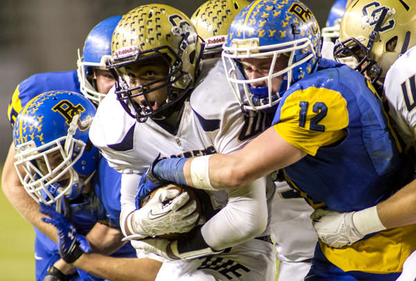 Central Catholic running back Montell Bland powers his way into the end zone against Bakersfield Christian defenders Hayden Kuchta (12) and Zach Balfanz (left) on Friday night in the CIF Division IV bowl game at StubHub Center.