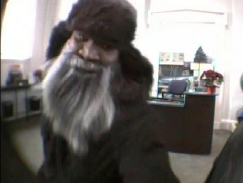 A surveillance camera at the PNC Bank in Laurel captured this image of a man who police say robbed the bank at gunpoint.