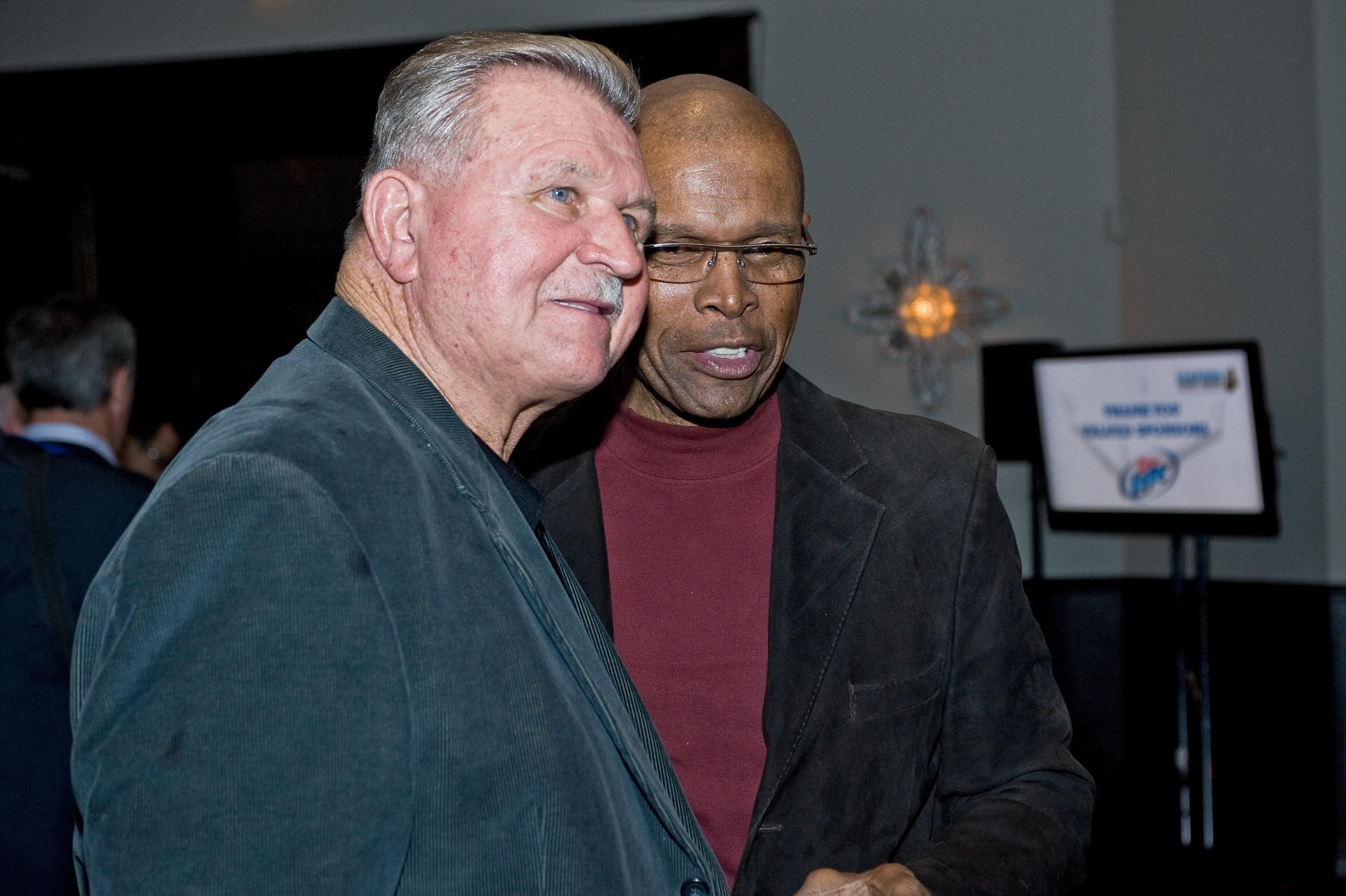 Mike Ditka (left) and Gale Sayers have shared good times and bad with their charities.