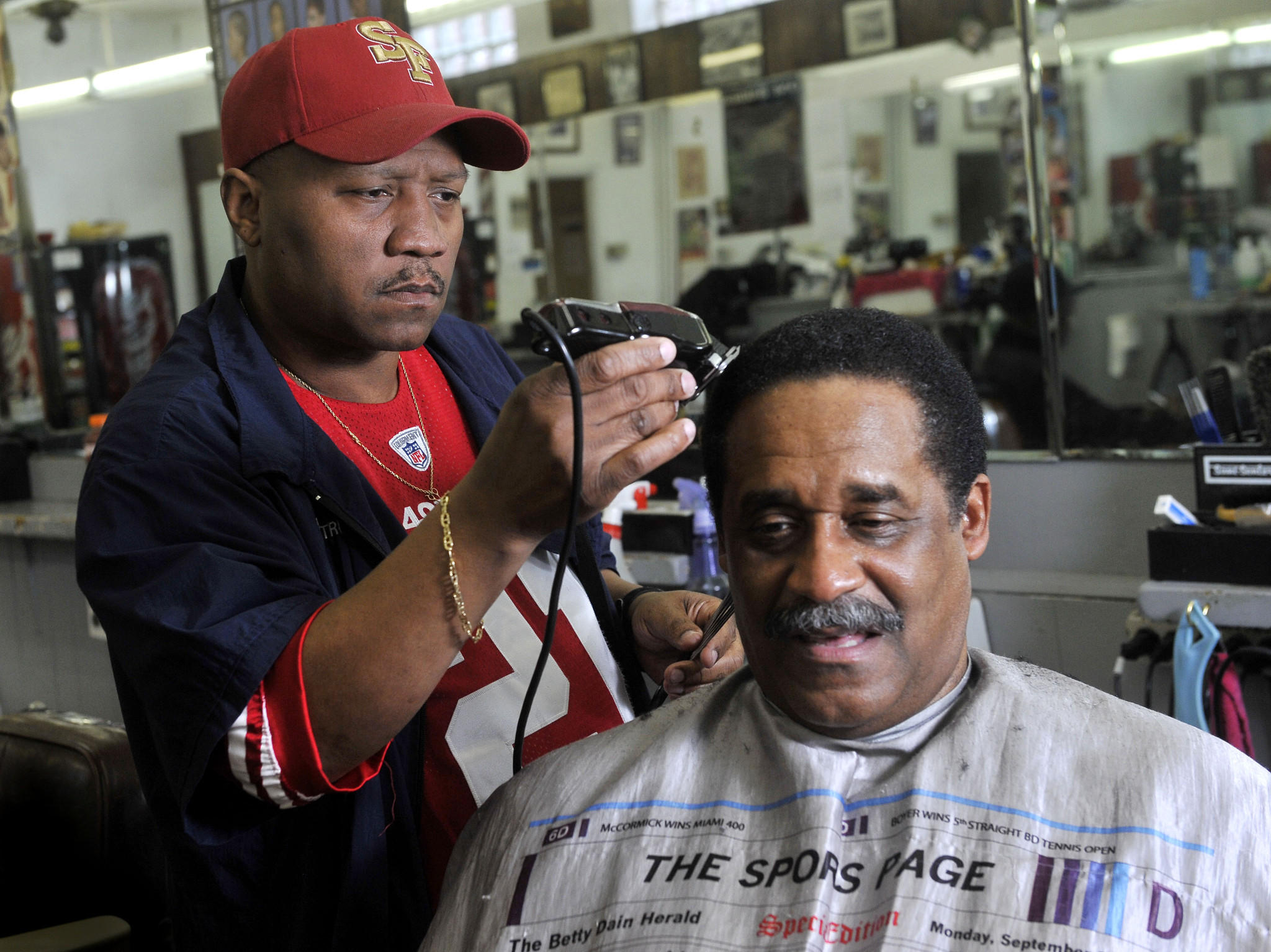 Nate Smith, an instructor at Avara's International Academy of Hair Design, works with customer Charles Blue of Owings Mills.