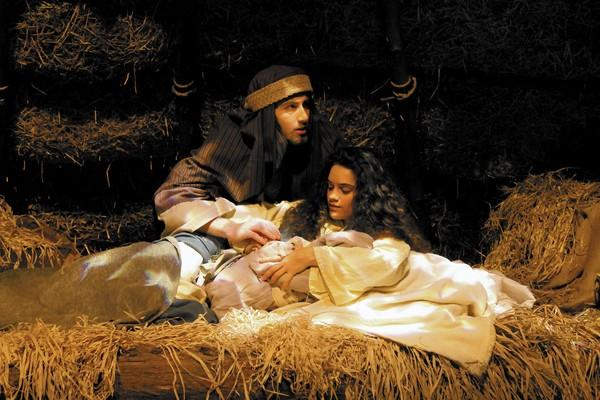 Mary, played by Mary Lu Hudgins, and Joseph, played by Kevin Bouley, lay in a stable with their new baby, Jesus, during the live nativity program at Northside Christian Church in York County.