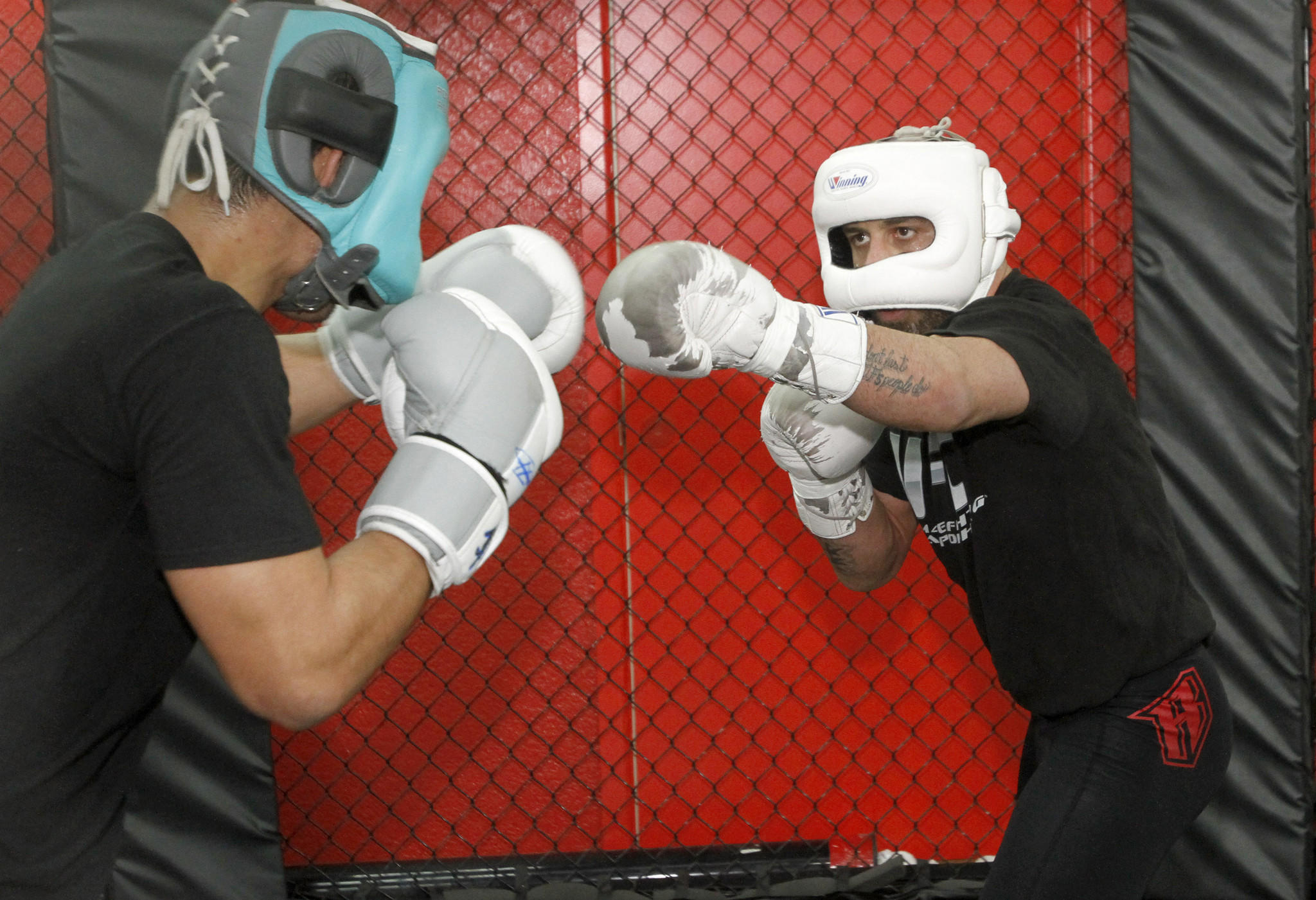 Manny Gamburyan, right, trains for his upcoming fight with sparring partner Alfred Khashakyan, left, at the Glendale Fighting Club in Glendale on Thursday, Dec. 19, 2013.