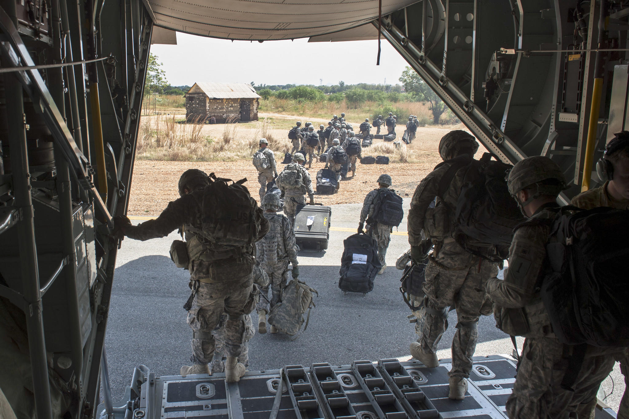Members of the East Africa Response Force, a Djibouti-based joint team assigned to Combined Joint Task Force-Horn of Africa, disembark from a U.S. Air Force C-130 Hercules in Juba, South Sudan, to assist with evacuation of Americans.