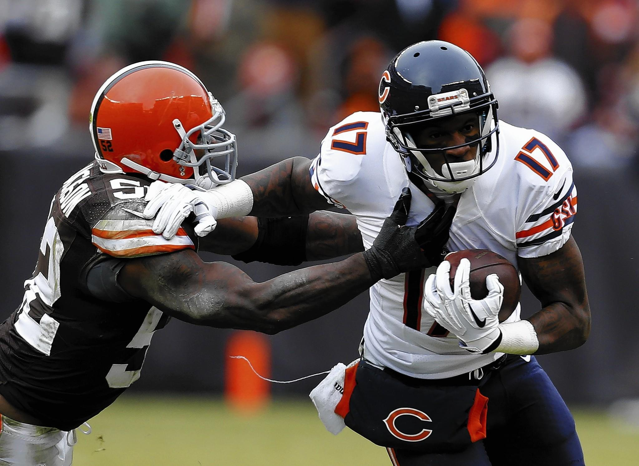 Wide receiver Alshon Jeffery #17 of the Chicago Bears runs by linebacker D'Qwell Jackson #52 of the Cleveland Browns at FirstEnergy Stadium on December 15, 2013 in Cleveland, Ohio.