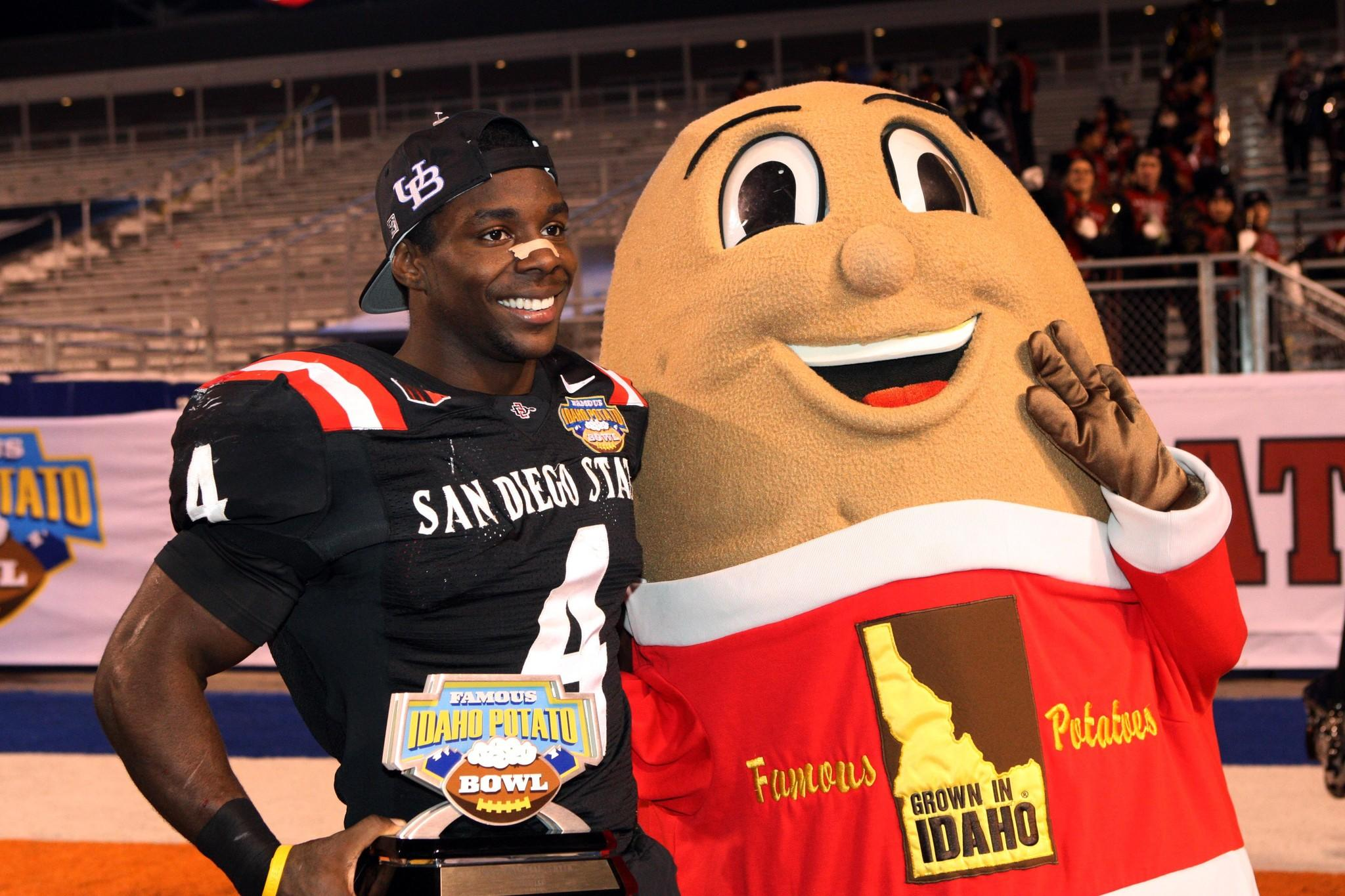 San Diego State running back Adam Muema holds the game MVP award after the Idaho Potato Bowl against the Buffalo Bulls at Bronco Stadium.