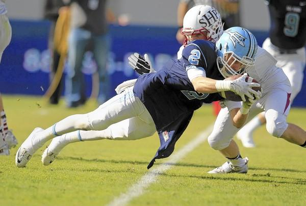 Corona del Mar High's Bo St. Geme (2) dives in for the first touchdown of the game during the first half against Sacred Heart Prep in the 2013 CIF State Football Division III Bowl Championship Game at StubHub Center in Carson on Saturday. (Kevin Chang/ Daily Pilot)