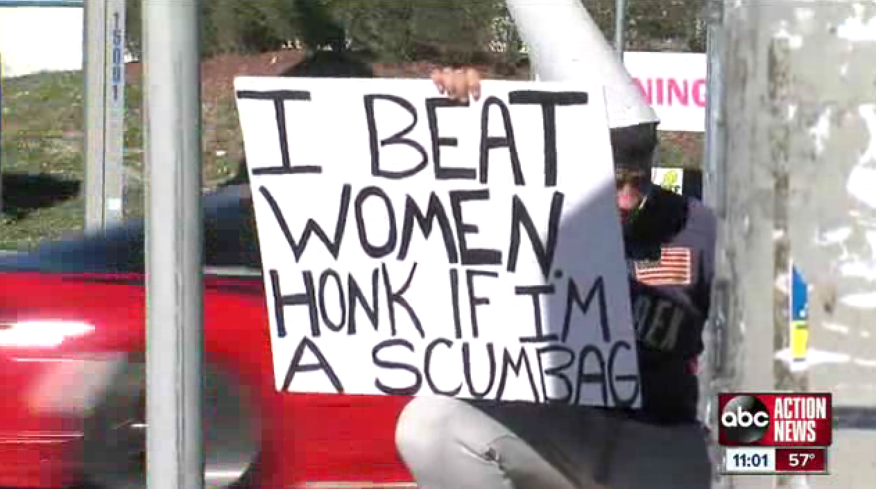 Tampa man holds 'I beat women' sign as punishment