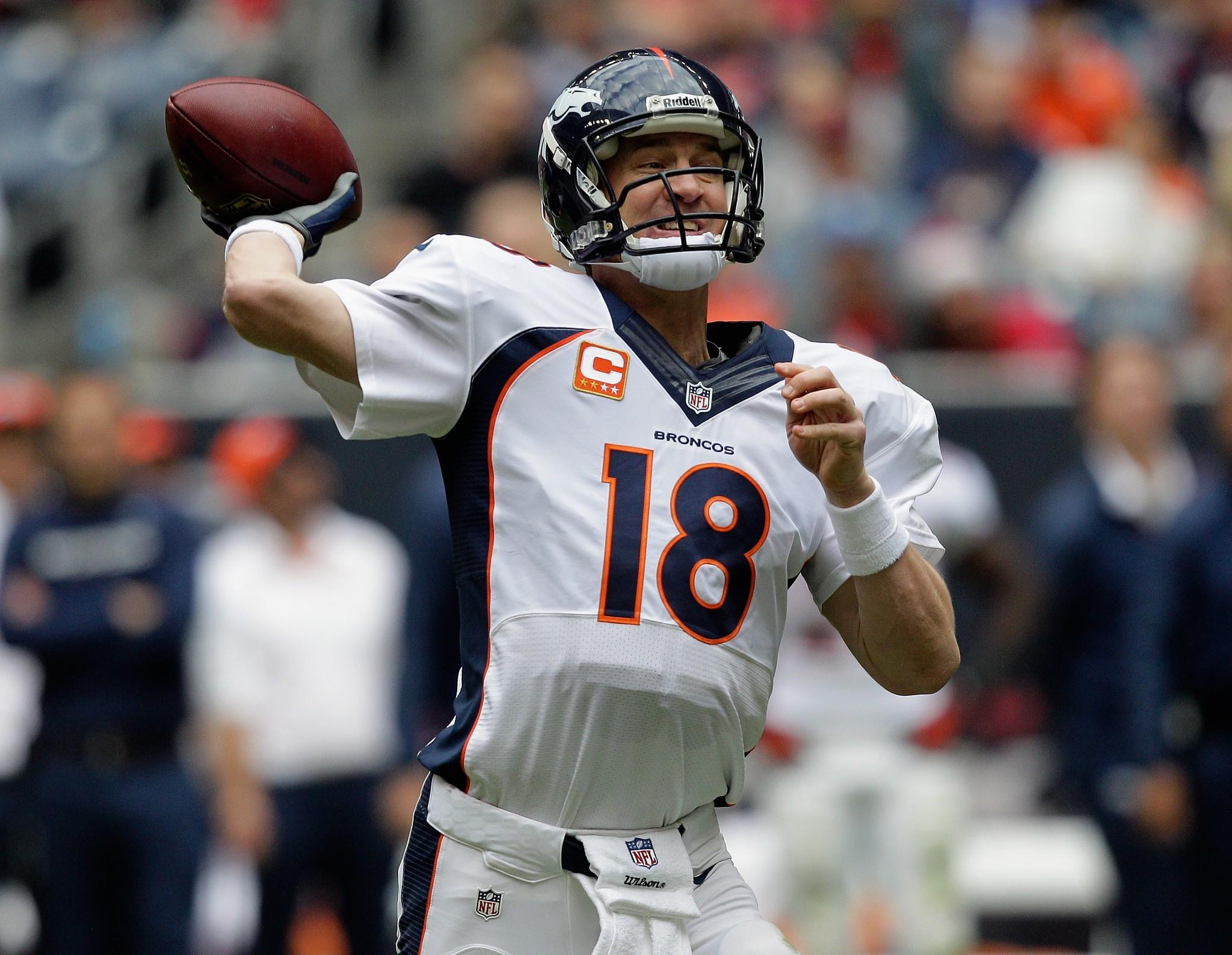 Peyton Manning of the Denver Broncos throws against the Houston Texans at Reliant Stadium.