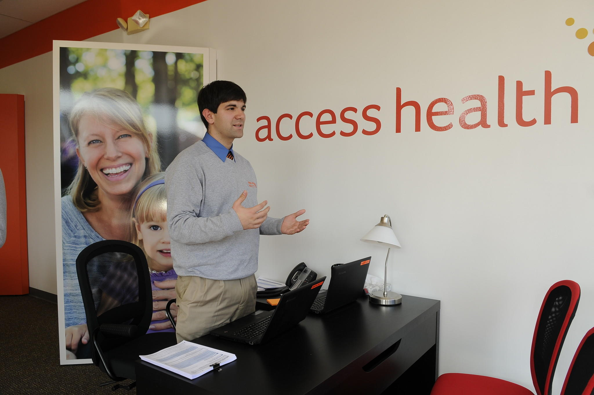 Outreach worker Luke Bajana stands inside Access Health CT's storefront in New Britain. About 85 percent of Connecticut's uninsured live in six cities targeted by Access Health: Hartford, Bridgeport, New Haven, Stamford, Waterbury and New Britain.