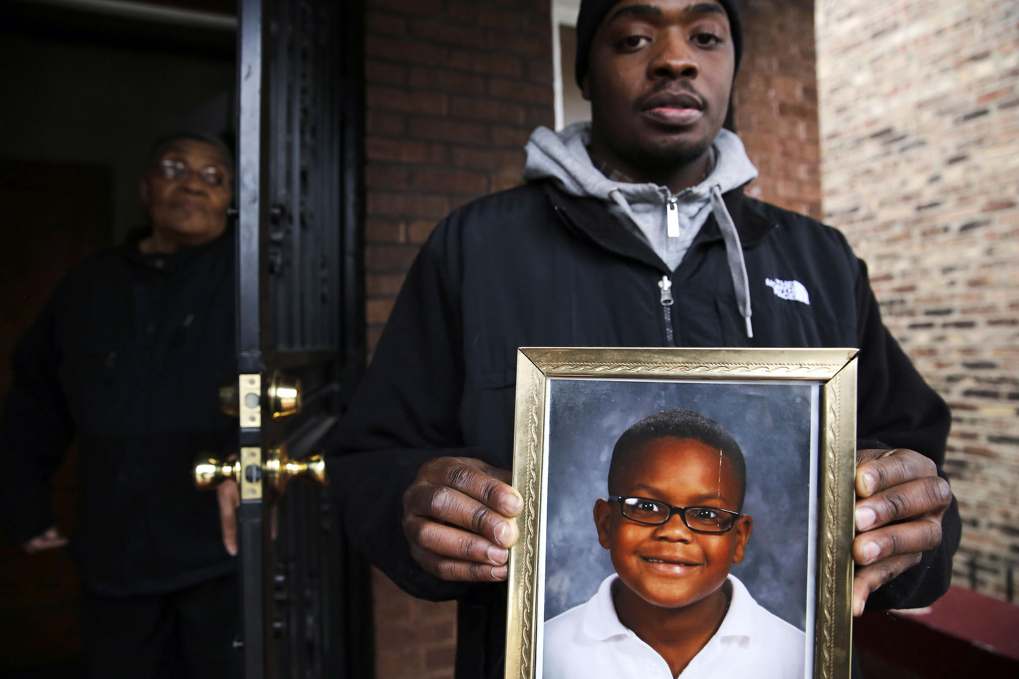 Richard Miller holds a photograph of his cousin, 11-year-old Donovan Turnage, who died Saturday afternoon after a traffic crash involving a stolen vehicle.