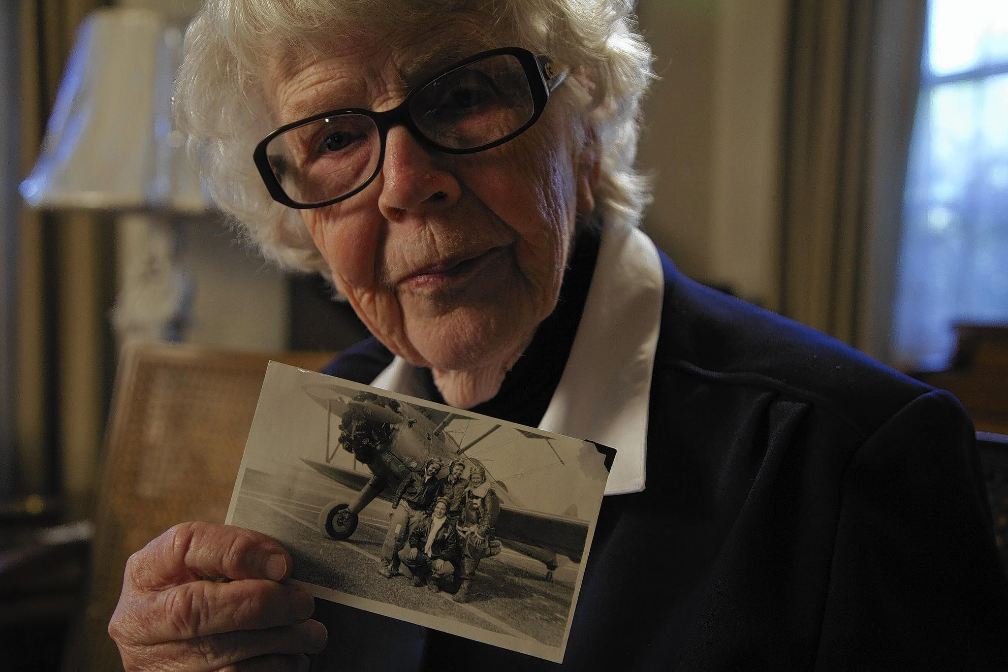 Flora Belle Reece holds a photo from her days as a WASP, training to be a WWII pilot in 1943. Now 89, Flora Belle is looking forward to riding in the Rose Parade on a float honoring the Women Airforce Service Pilots.