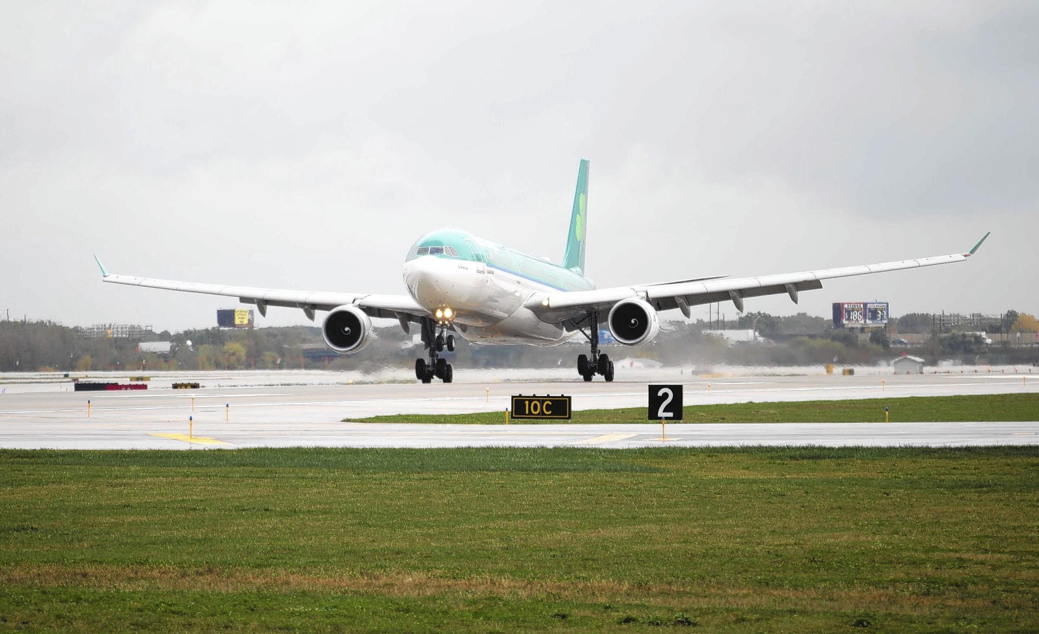A plane arrives on the newest runway at O'Hare International Airport in October.