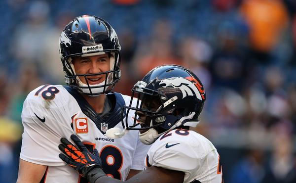 Denver quarterback Peyton Manning is congratulated by teammate Montee Ball, right, after breaking the NFL record for most touchdown passes in a season with 51 during the Broncos' 37-13 win over the Houston Texans on Sunday.