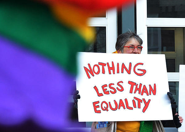Sue Janoski, of South Whitehall holds a sign during a candlelight vigil for marriage equality at the Federal Courthouse in Allentown, organized in partnership with Equality Pennsylvania and Eastern PA PFLAG in March.