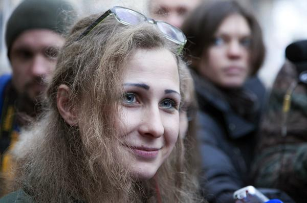 Maria Alyokhina, one of the jailed members of anti-Kremlin punk band Pussy Riot, is pictured after being freed Monday. (Anastasiya Makarycheva / AFP / Getty Images / December 23, 2013)  http://www.latimes.com/world/worldnow/la-fg-wn-pussy-riot-free-20131223,0,134599.story#ixzz2oJY35tzJ