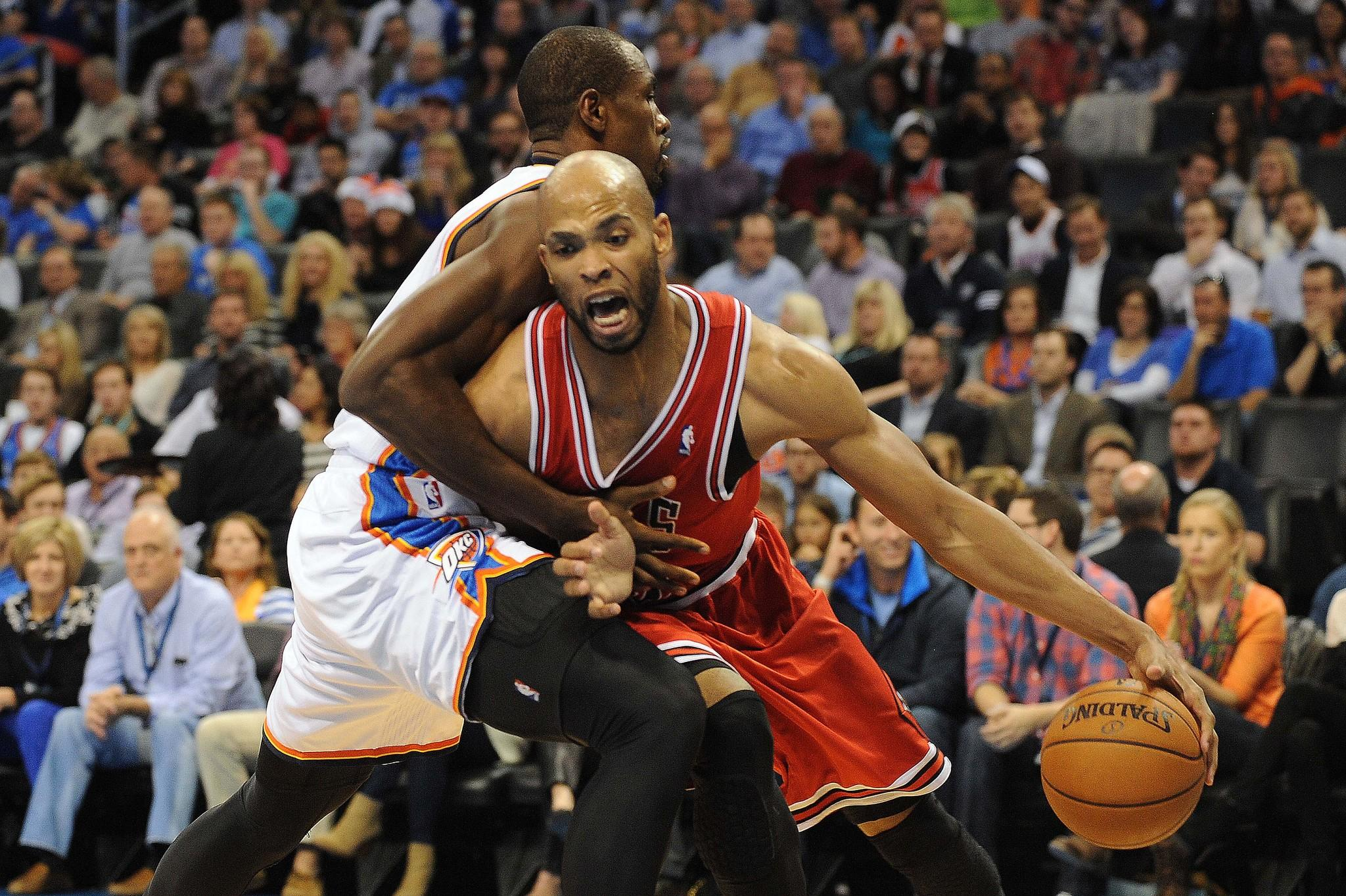 Chicago Bulls power forward Taj Gibson (22) dribbles the ball while defended by Oklahoma City Thunder power forward Serge Ibaka (9) during the second quarter at Chesapeake Energy Arena.