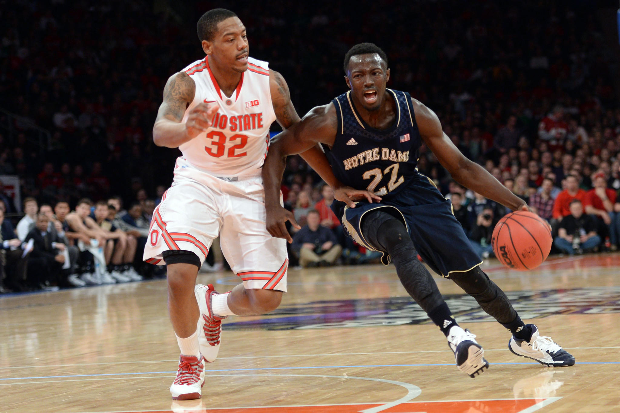 Ohio State Buckeyes guard Lenzelle Smith Jr. (32) stays with Notre Dame Fighting Irish guard Jerian Grant (22) during the first half of the Gotham Classic at Madison Square Garden.