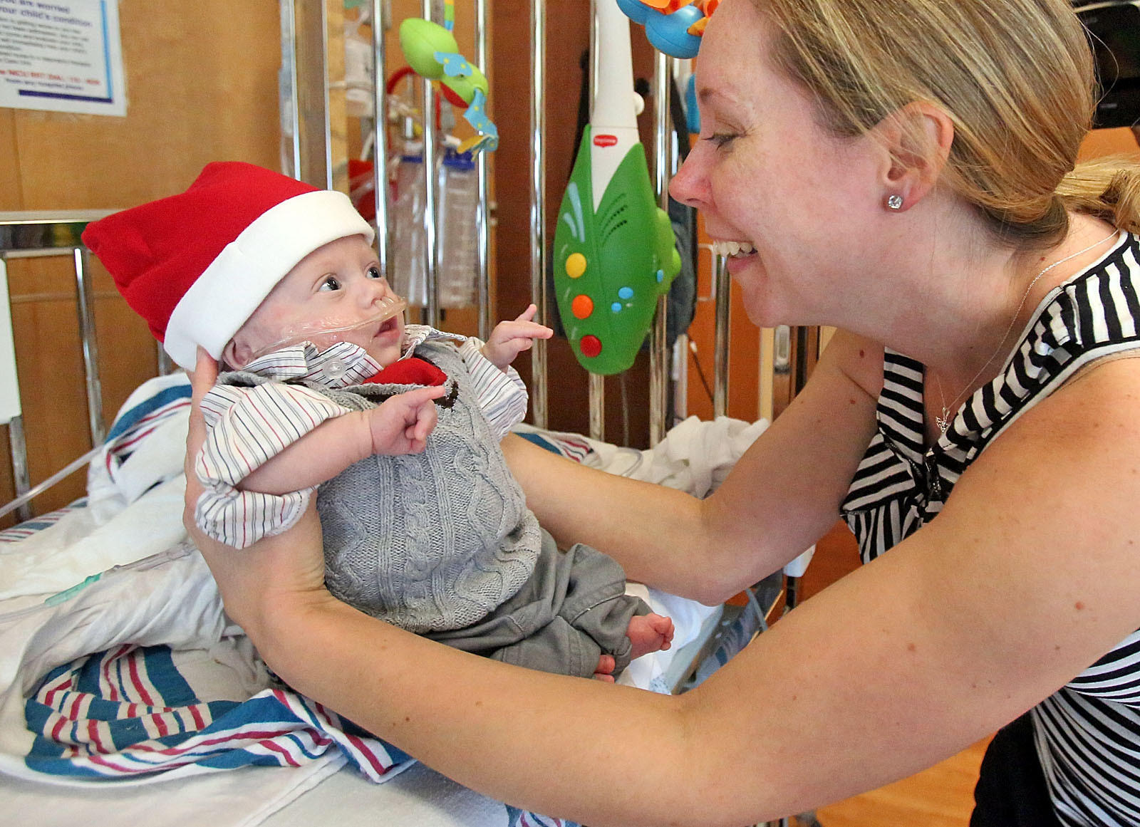 Holly Sorensen, 37, of Winter Garden holds her son Connor at Florida Hospital for Children. Connor is the smallest baby ever born at Florida Hospital, born June 29 at 24 weeks weighing just 14 ounces. Connor is going home with his parents for his first Christmas.
