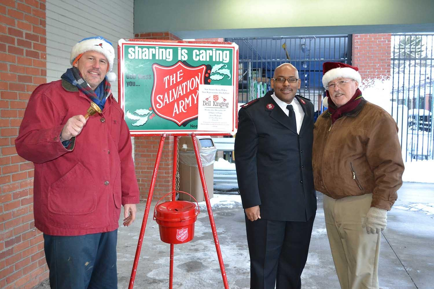 State Sen. Kevin Witkos, left, and state Rep. Tim LeGeyt, at right, were recently at the Walmart in Avon to help with the Salvation Army's Red Kettle Campaign. With them is Salvation Army Major Brian Glasco