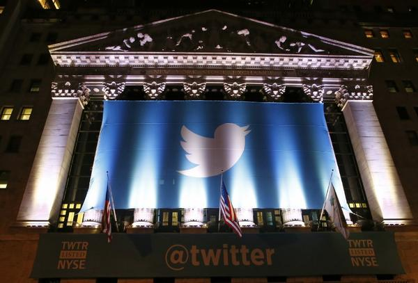A banner adorns the facade of the New York Stock Exchange in advance of Twitter's initial public offering Thursday, Nov. 7, 2013, in New York.