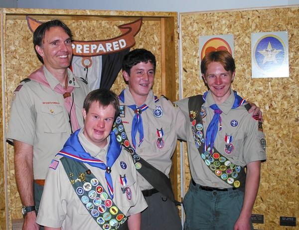 Chad Dominguez, 25, bottom, has reached the level of Eagle Scout with the help of Scoutmaster Dennis Moder, left. Dominguez's achievement is made more poignant by the fact that he is one of the few scouts at his level with Down syndrome.
