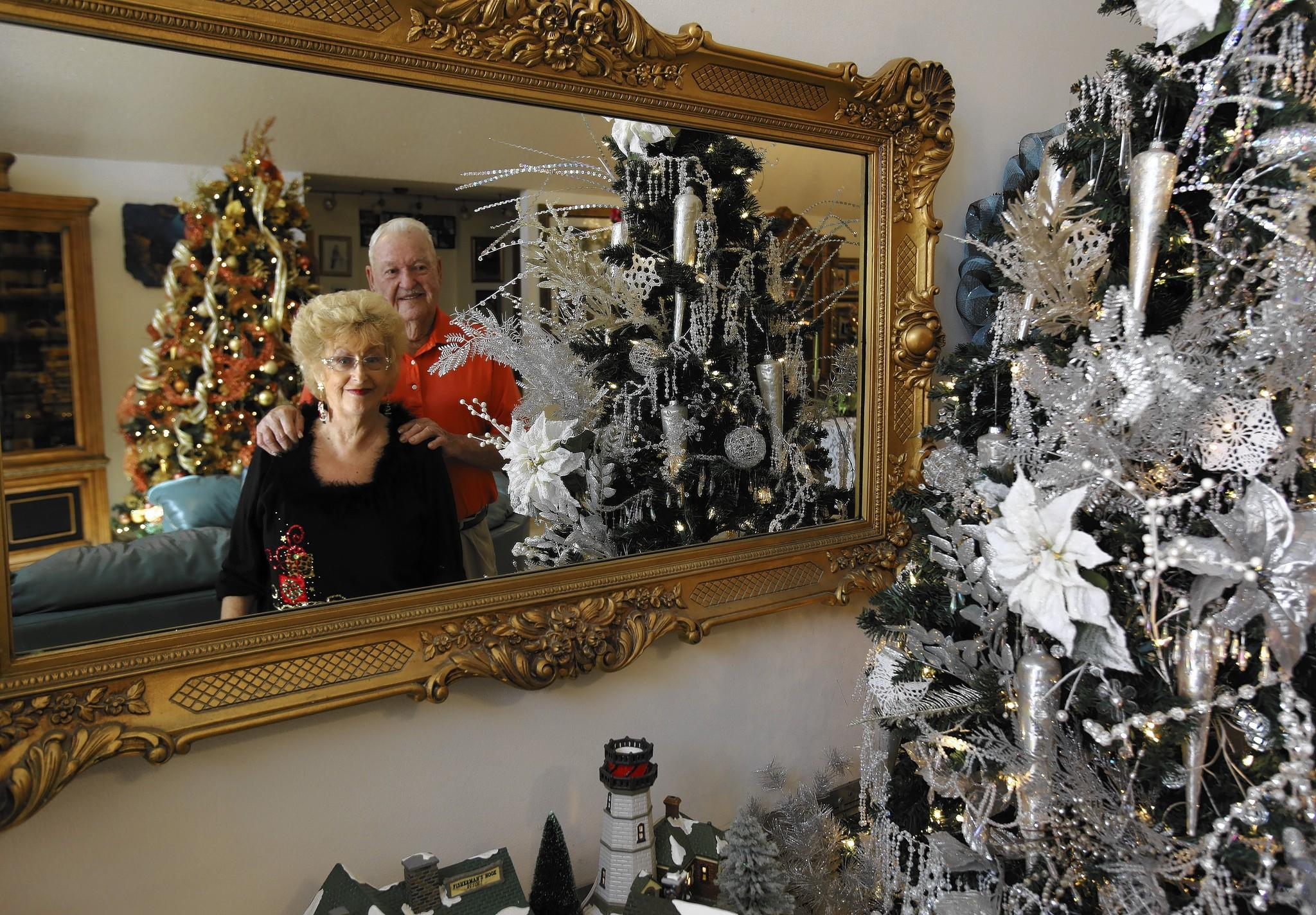 Art and Sharon Womble decorate their home with 40 7-foot Christmas trees every year. Art Womble helped start the Light Up Mount Dora event in 1986, when he worked for the city.