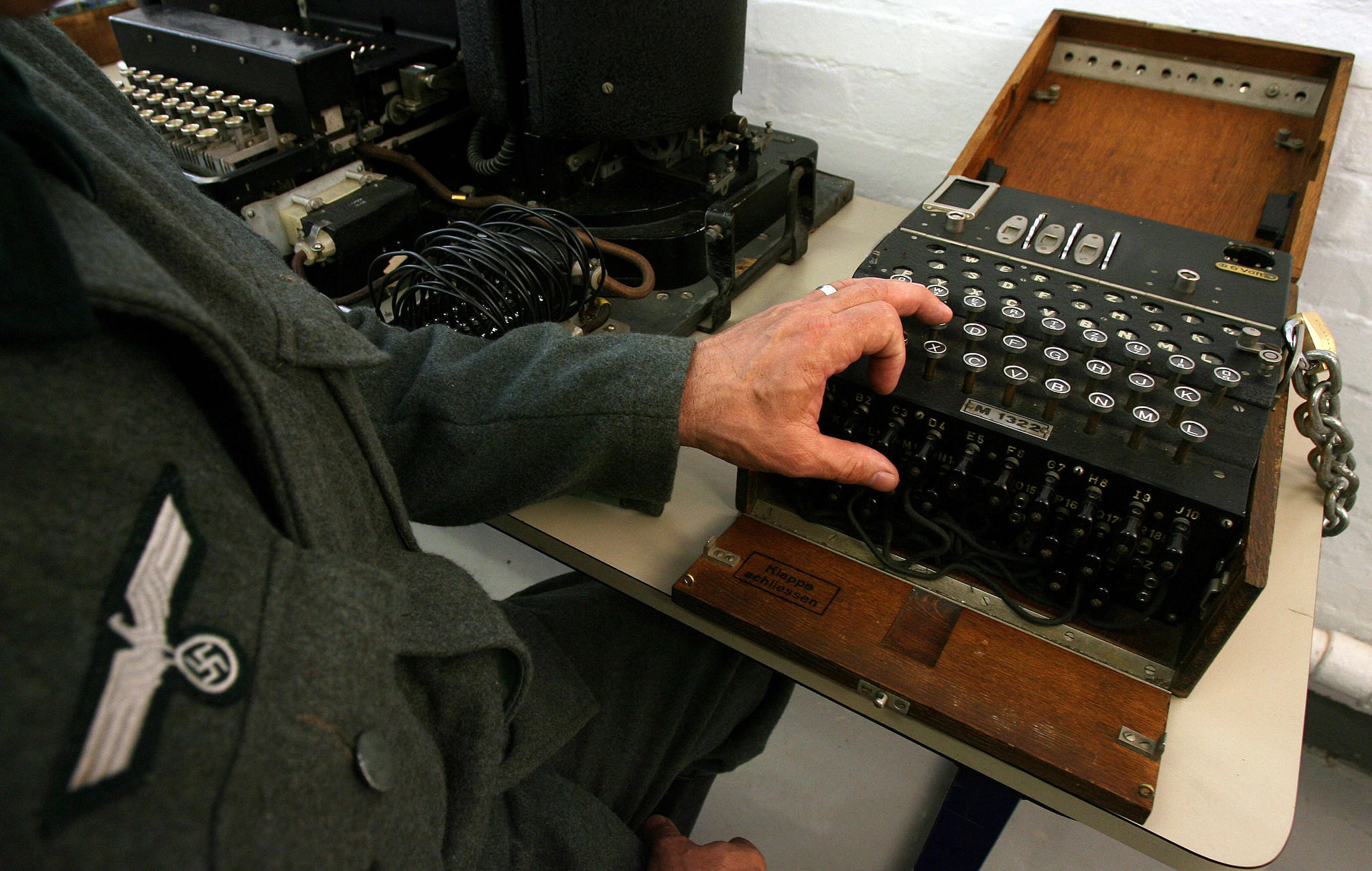 An actor dressed as a German soldier shows off an Enigma machine. Alan Turing and Gordon Welchman enabled cryptographers to decode over 3000 enemy messages a day breaking the codes created by German military Enigma machines. REUTERS/Alessia Pierdomenico