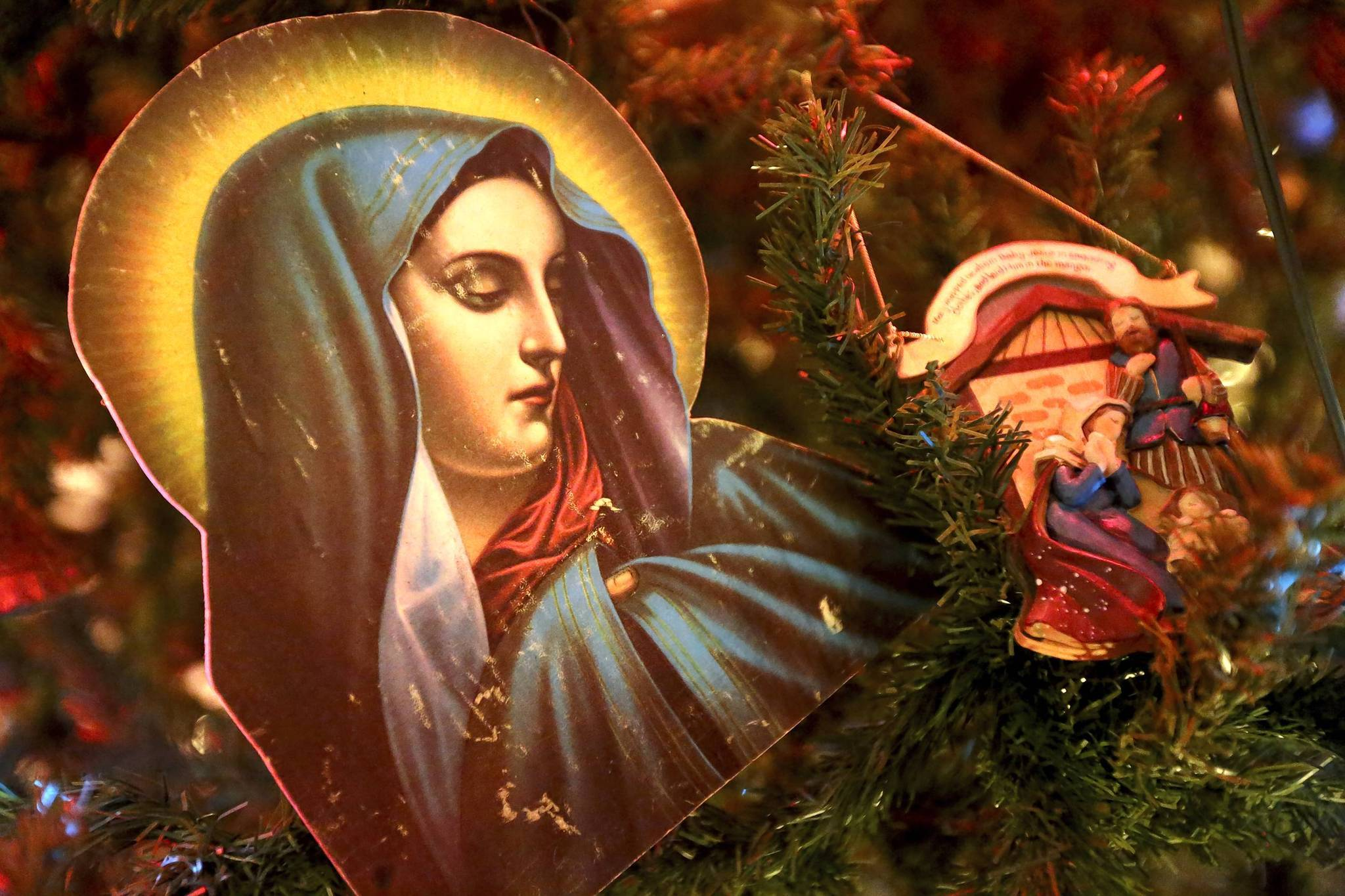 Religious icons adorn a Christmas tree representing Egypt's participation on display at a Museum of Science and Industry exhibition.