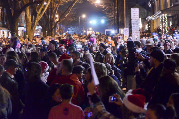 "People singing Christmas carols fill the block in front of the West Reading, Pa., home of Delaney ""Laney"" Brown, 8, who is terminally ill with a rare form of leukemia."